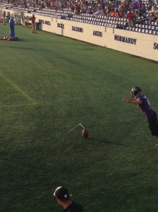 Raven's kicker Justin Tucker practices his accuracy nearly in-line with the goal post.